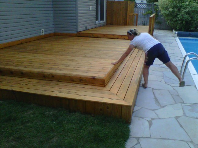 Checking the Finish on a Cedar Deck