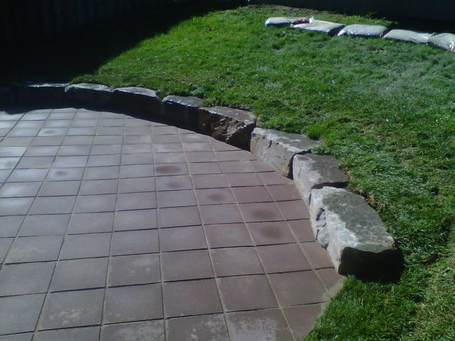 Inexpensive paver laid on an angle set off by armourstone